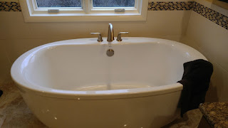 A large stand-alone bath tub