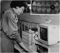 Image of woman working with CD-ROMs