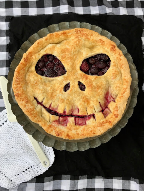 Finished Jack Skellington boo berry pie in a pie plate.