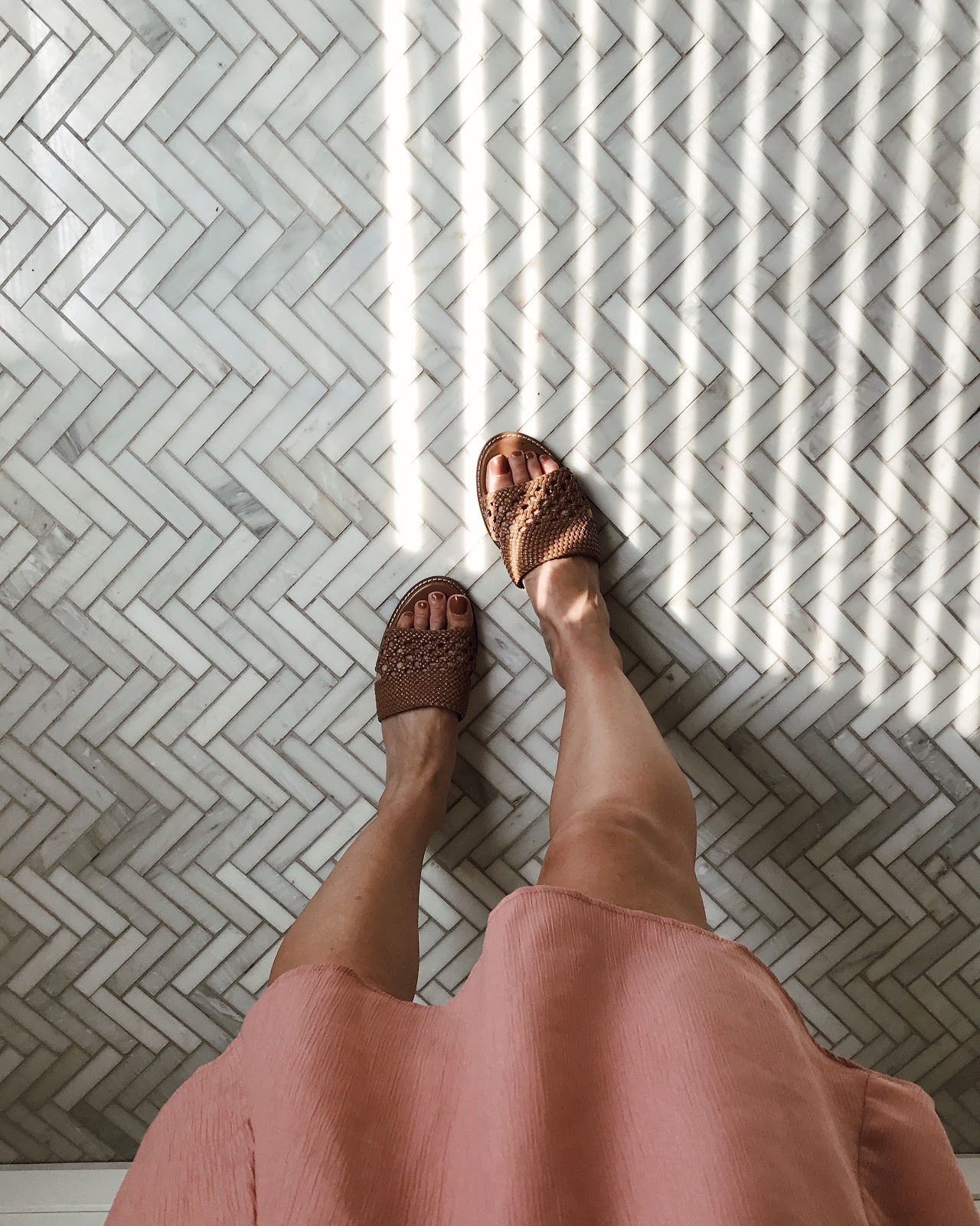 Slide sandals / herringbone tile floor