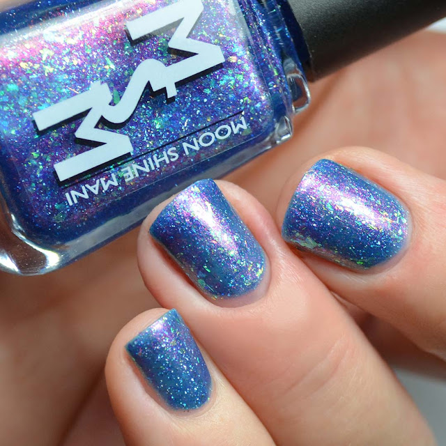blue shimmer nail polish with flakies swatch