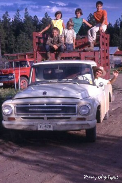 Dad Driving Truck With Kids on North Dakota Farm