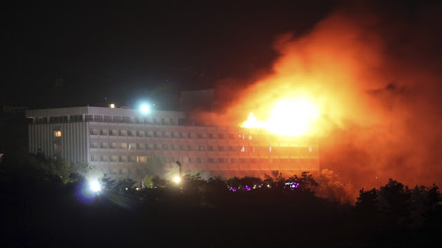 Image Attribute: A 2011 image showing smoke and flames rising from Kabul InterContinental Hotel after coming under attack. Source: Reuters
