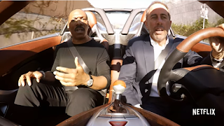 Eddie Murphy and Jerry Seinfeld in a car