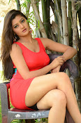 Poojitha sizzling in red dress-thumbnail-14