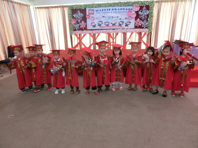lil' Iman on his playschool convocation day