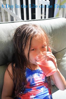girl drinking Frozen Strawberry Mocktail