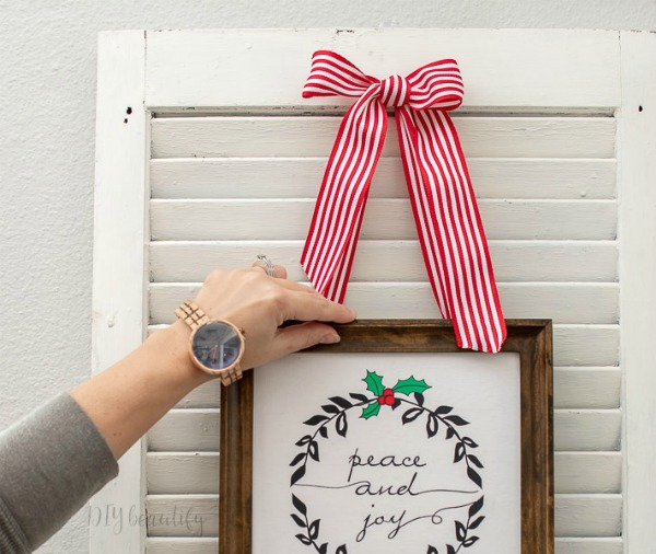 white shutter with Christmas sign