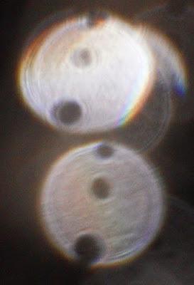 column of orb holes