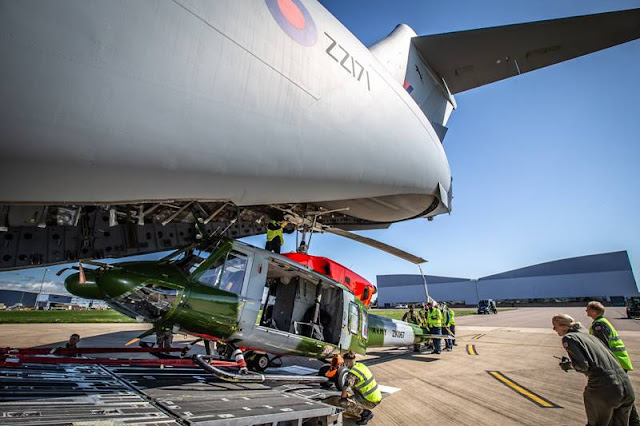 RAF C-17 loads Army helicopter
