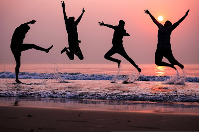 People jumping on the beach. Love pattern