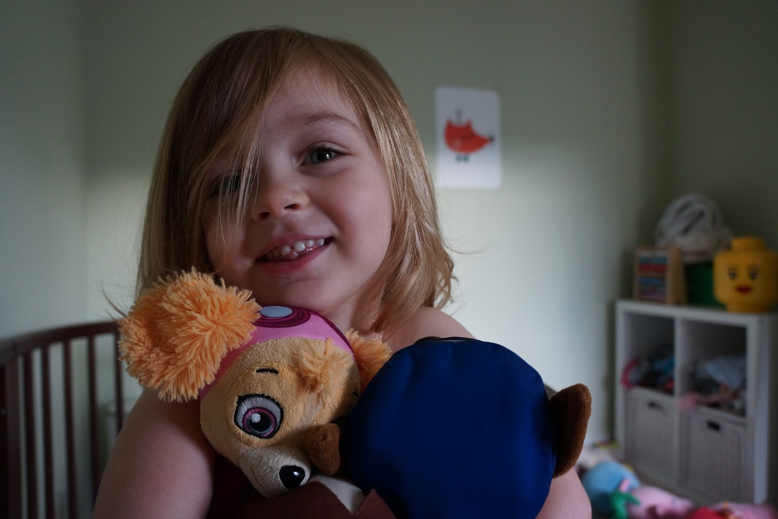 little girl smiling and holding teddies - how my kid tries to avoid sleeping