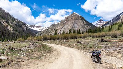 T-Dub ing to the summit of Cinnamon Pass and riding near American Basin