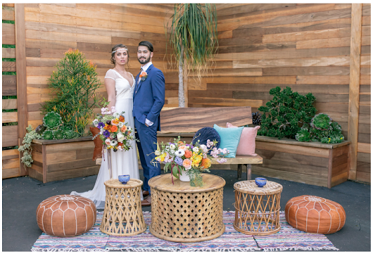 BOHEMIAN STYLED WEDDING WITH UNIQUE TIRE BACKDROP