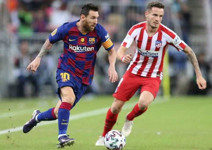 Lionel Messi in action against Saul Niguez