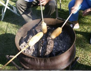 dough cooking on a stick over campfire- brown bear recipe