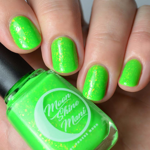 bright green nail polish with flakies four finger swatch