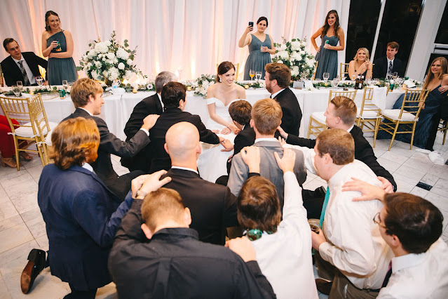 wedding guests dancing with bride and groom