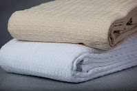 two woven cotton hotel blankets