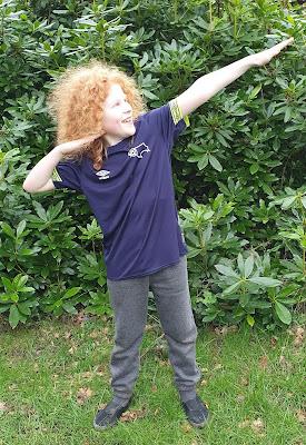 Boy pretending to be runner Usain Bolt