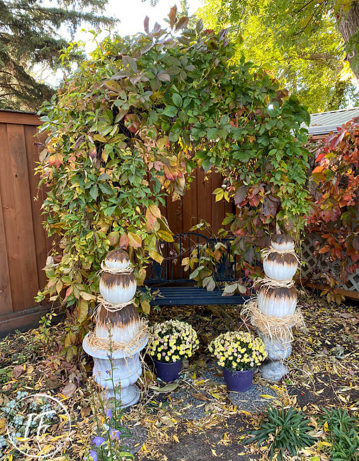 Rusty Abstract Painted Pumpkin Topiaries, a unique non-traditional twist for faux stacked outdoor pumpkins and fun to watch the rust magically happen!