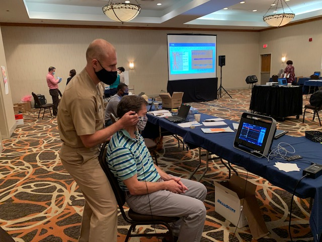 Navy Capt. (Dr.) J. Kent Werner simulates how they may test for sub-concussive brain injury. (Courtesy photo)