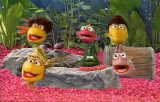 Telly the fish, sings Telly's Aquarium. Sesame Street Best of Friends