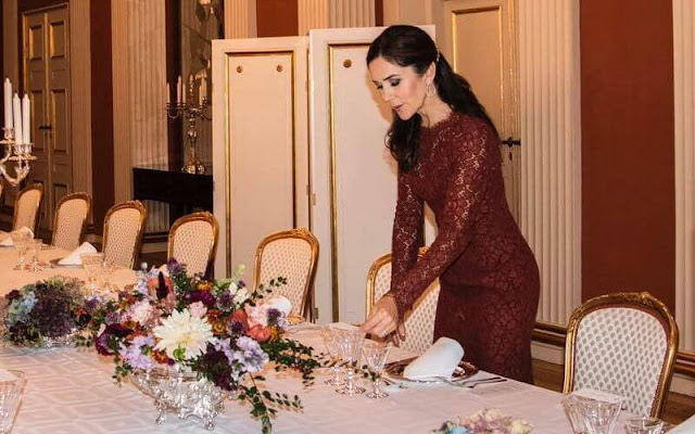 Crown Princess Mary wore a plum floral lace dress by Dolce and Gabbana, long sleeves and scalloped eyelash lace around