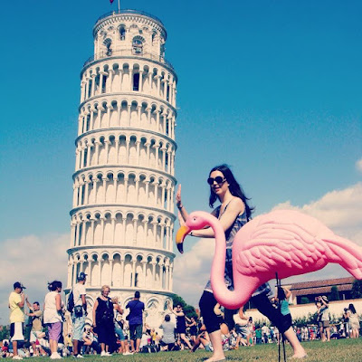 Travel mascot at leaning tower of Pisa
