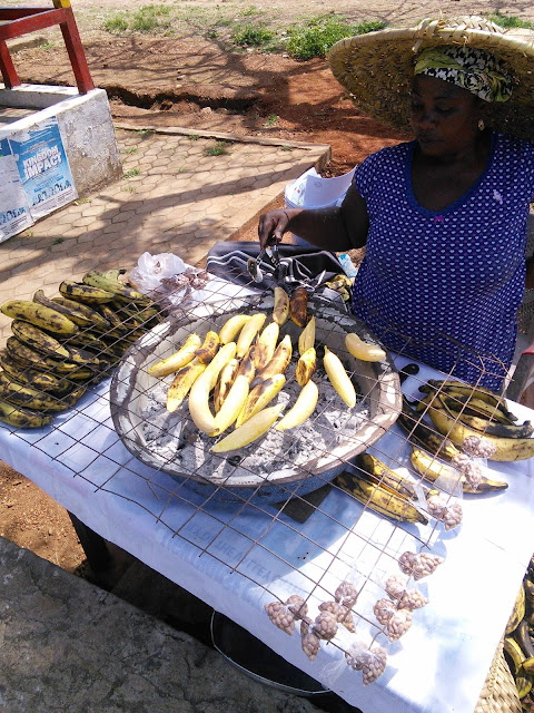 woman roasting plantain