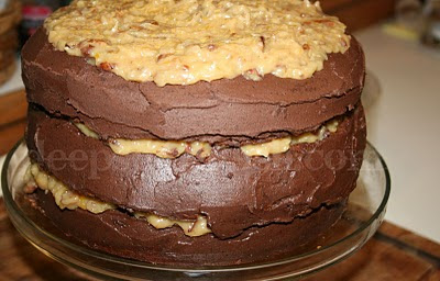 A classic, homemade German chocolate cake, except instead of spreading the traditional coconut pecan frosting all over the cake, I've added a new twist of chocolate ganache.