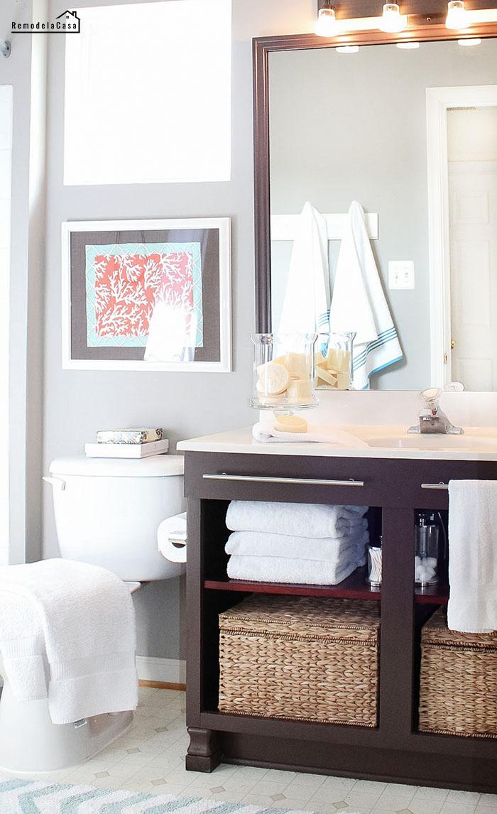 Gray, orange bath makeover with dark furniture