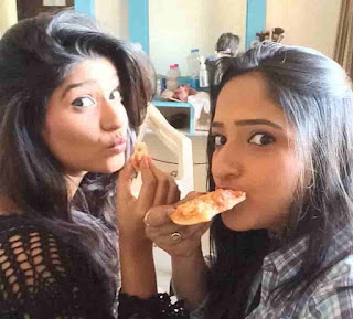 Rasika Sunil Eating Pizza