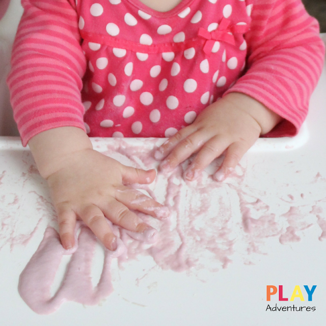 Messy baby hands playing with gloop