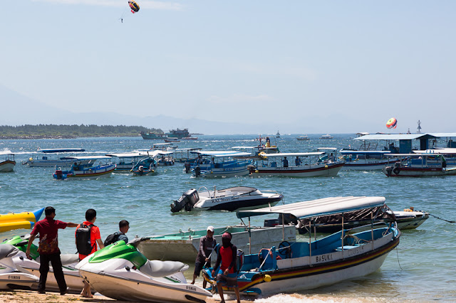 people and speed boats at nusa dua beach in nusa dua bali indonesia
