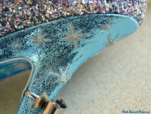 irregular choice sparkling slipper metallic blue heel close up