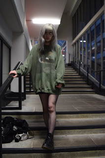 silver haired girl wearing oversized jumper and fishnets