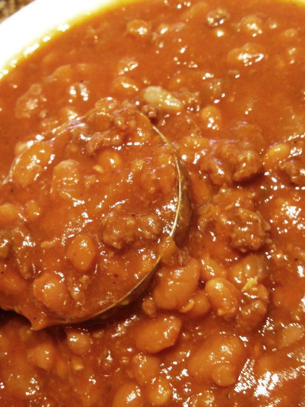 Cowboy Beans | A hearty recipe made with pork n' beans, ground beef, brown sugar and barbeque sauce that's perfect for cookouts, barbeques and covered-dish affairs (made in the slow cooker or on the stove top).