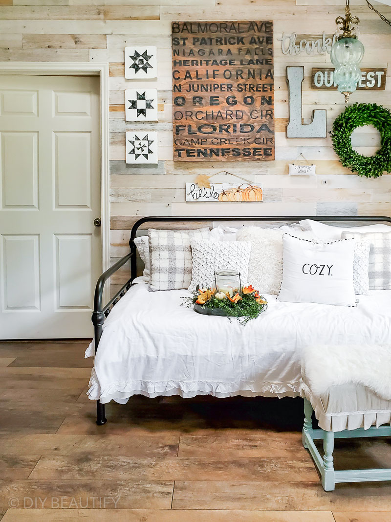 vintage daybed and reclaimed wood wall