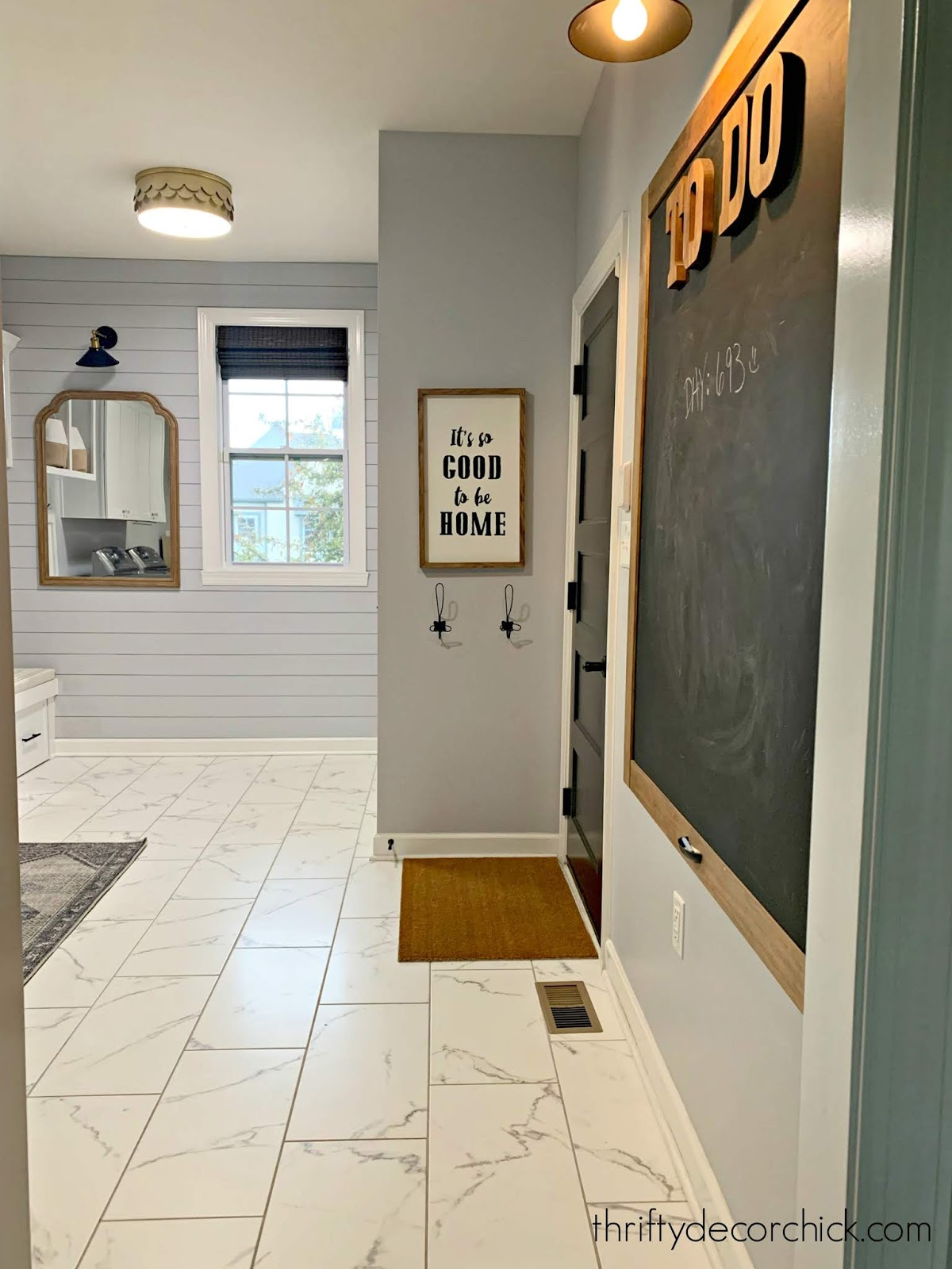 mud room laundry combo marble floors
