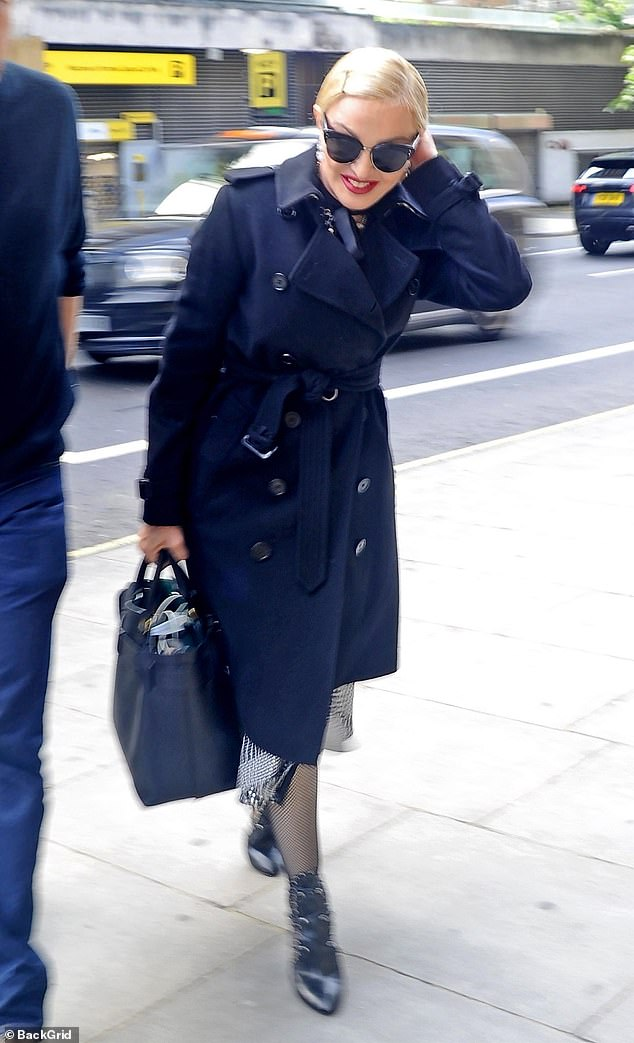 Madonna steps out in a conservative trench coat