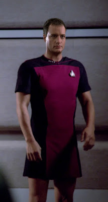 Q wearing TNG skant uniform