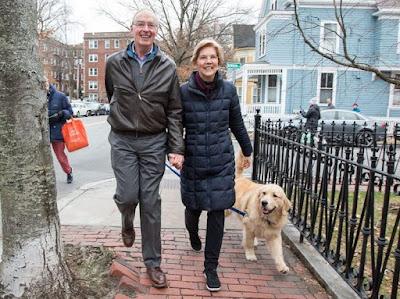 Elizabeth Warren walking holding hand with her husband Bruce