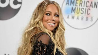 Mariah Carey becomes the first artist with No. 1 hits in four separate decades