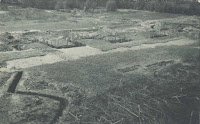 A black and white photograph of the Occom Trenches.