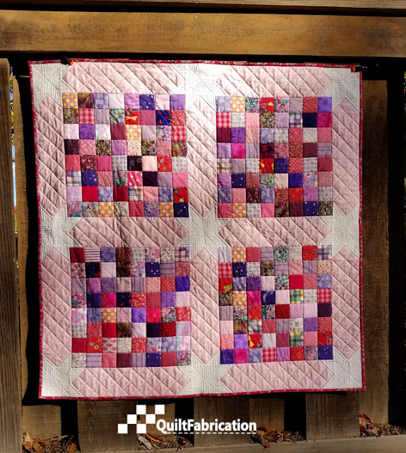 Scrap Happy baby quilt made from charm squares