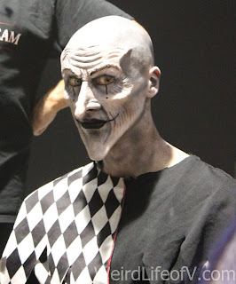 Scary harlequin clown prosthetic makeup completed