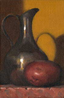 Still life oil painting of a pewter jug next to a Désirée potato.