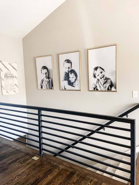 black and white poster prints over modern stairs