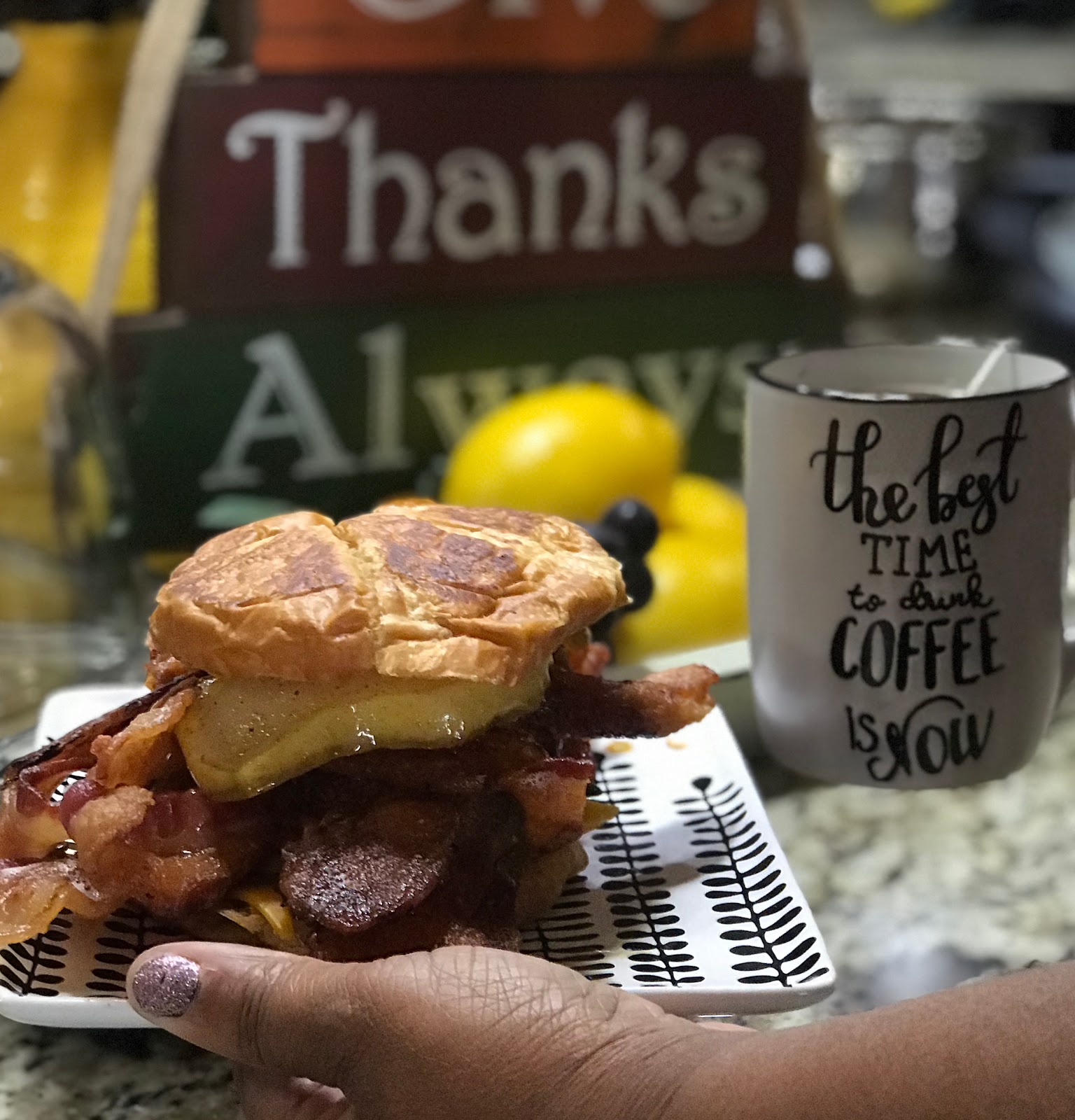 Tangie Bell is sharing the completed sammich: Stacked with lots of bacon, egg, cheese and pears in a sweet sauce